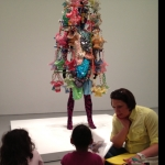 Pre-K family workshop in front of Nick Cave's Soundsuit.
