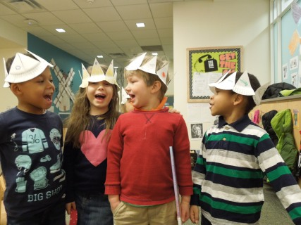 Four year olds create crowns after learning about the royal court during a unit on Don Quixote.