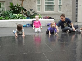 Toddlers learning about states of matter, used the fountain at Smithsonian American Art/ National Portrait Gallery during a lesson on liquid water.