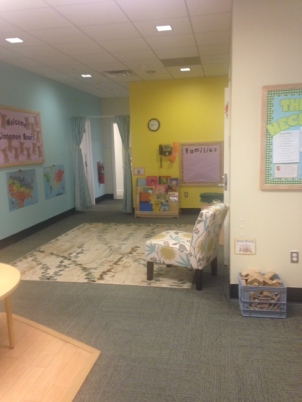 Who wouldn't want to meet here? This PreK 4 space is the spot for meetings and playing. The displays reflect the students and what they are learning.