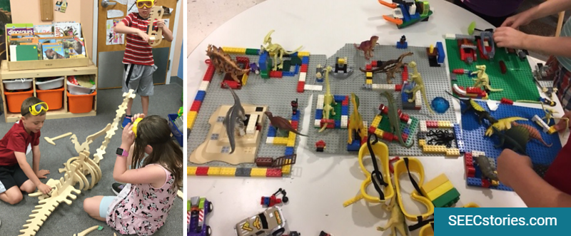 Children playing with legos and toy dinosaurs