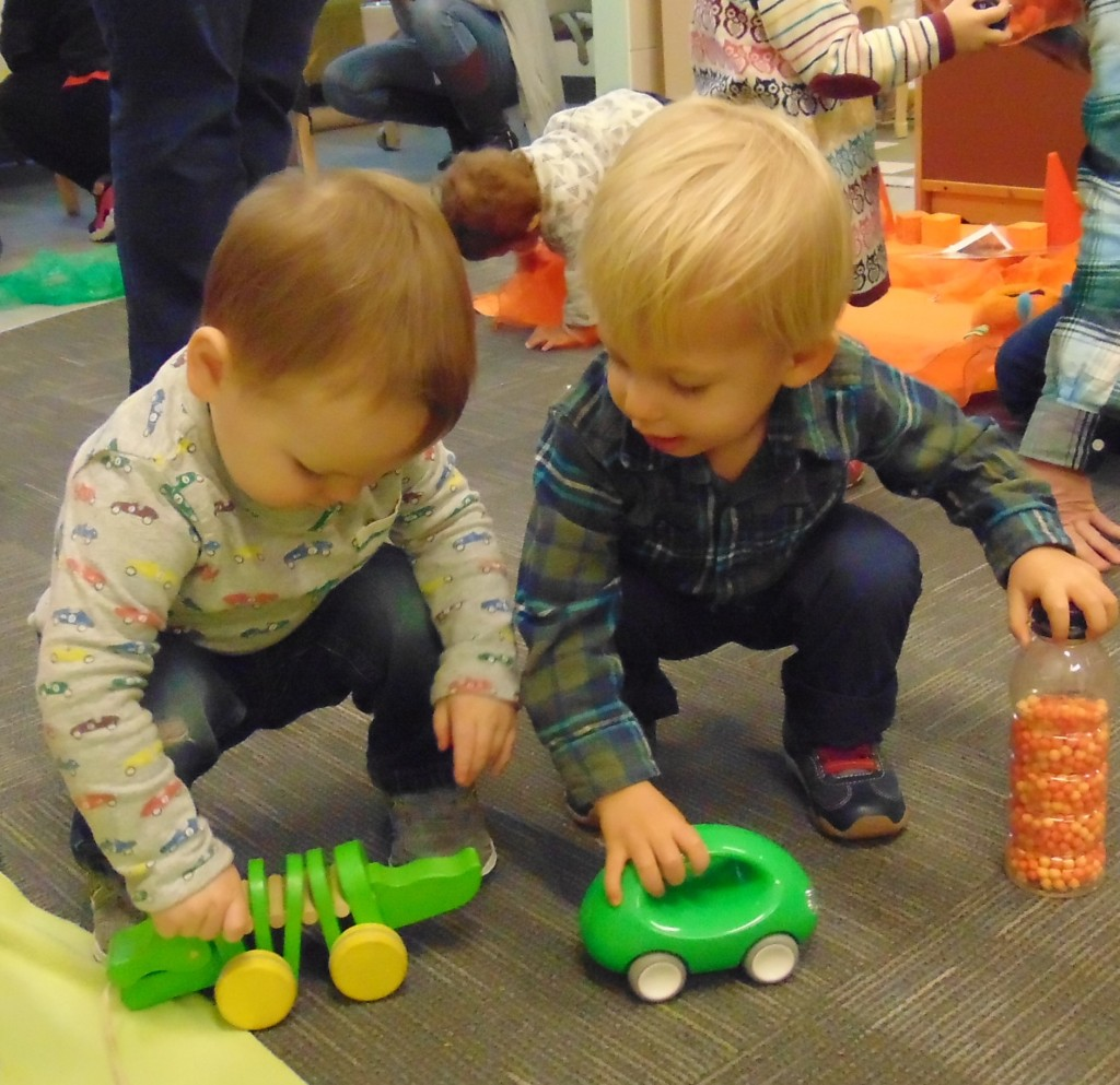Two children playing with toys.